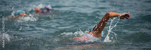 Canvastavla Competitors swimming out into open water at the beginning of triathlon
