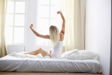 Woman Stretching In Bed After ...