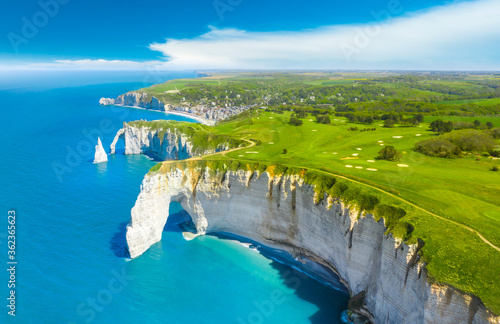 Picturesque panoramic landscape on the cliffs of Etretat. Natural amazing cliffs. Etretat, Normandy, France, La Manche or English Channel. Coast of the Pays de Caux area in sunny summer day. France #362365623