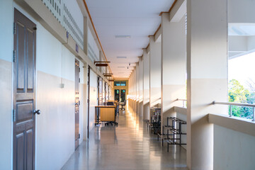 High School hallway corridor in College or university empty hall at classroom, no people student while closed quarantine in situation of Covid-19 disease outbreak result in inability organize learning