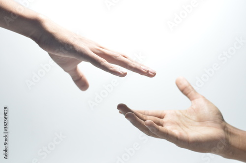 Two male hands reaching towards each other on isolated white background Wallpaper Mural