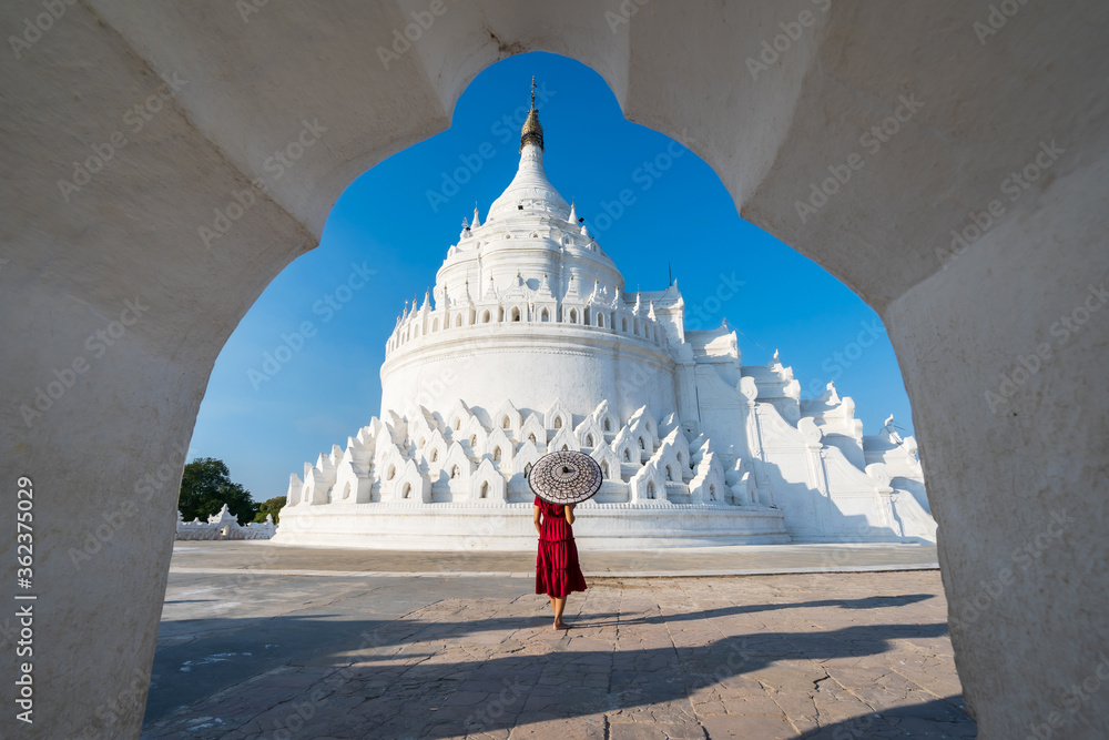Fototapeta Young woman traveler at Hsinbyume Pagoda (white pagoda) the famous destination in Myanmar