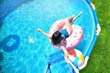 Pool Time. Girl Has Fun In A S...