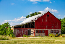 Old Red Barn Falling Down In The Midwest