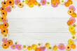 Flowers composition. Frame made of various yellow flowers on white background. Easter, spring, summer concept. Flat lay, top view,