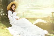 Romantic Woman Victorian Retro Style, Fashion Model In White Dress Wide Brim Hat Reading Book, Outdoor Beauty Portrait
