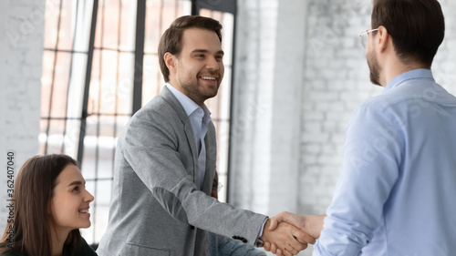 Photo Executive manager welcoming investor during business formal meeting at office board room