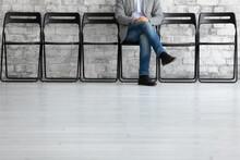 Man Sit Cross Legs On Chair In...