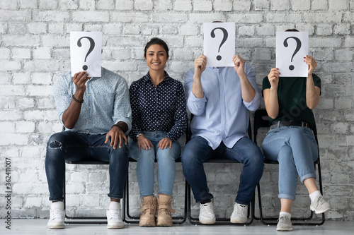 Canvastavla Girl applicant sit on chair with unknown diverse competitors people hiding face