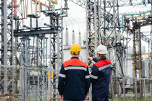 Two Specialist Electrical Substation Engineers Inspect Modern High-voltage Equipment. Energy. Industry