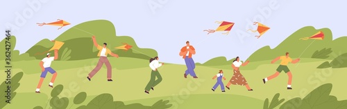 Happy people and children run and fly colorful summer kites in green park, playing in the wind Canvas Print