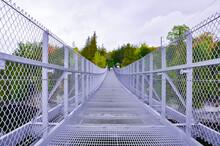 Suspended Metal Bridge Over The River
