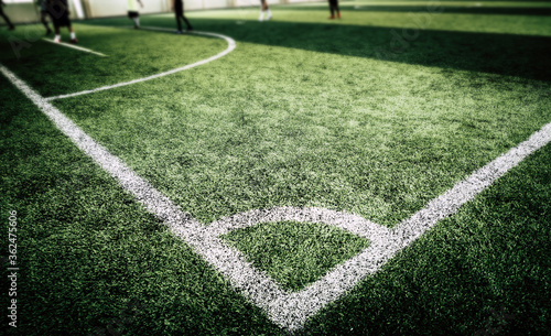 Football Corner white line on green artifact grass of soccer indoor pitch Canvas Print