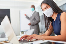 Businesswoman With Face Mask W...