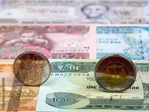 Cuadros en Lienzo Ethiopian coin on the background of money