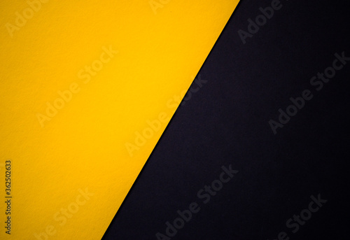 Photographie Yellow and black abstract diagonally divided background