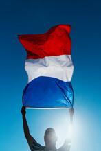 Man Waving A French Flag On Th...