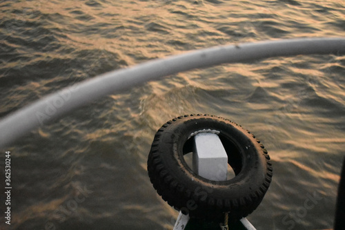 a spare tire kept in a boat , floating in a sea Tableau sur Toile