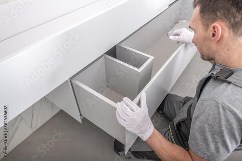 Fototapeta Furnishing Technician Finishing Custom Made Bathroom Furniture obraz