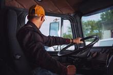 Trucker In His 40s Inside Vintage Aged Semi Truck Tractor Cabin