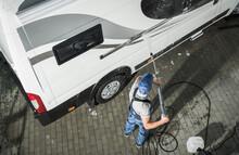 RV Service Worker Pressure Washing Camper Van