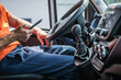 Leinwanddruck Bild - Delivery Truck Driver Browsing Internet Using His Smartphone
