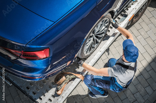 Fotografiet Brand New Car Home Delivery on Towing Truck
