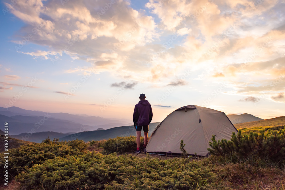 Fototapeta tourist tent and sportsman in mountains, summertime