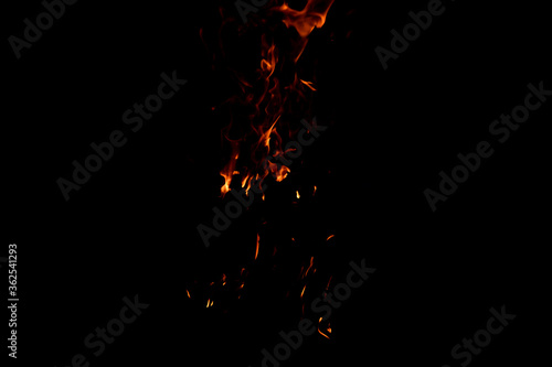 Bright firelight on a black background. Sparks and flames. Canvas Print