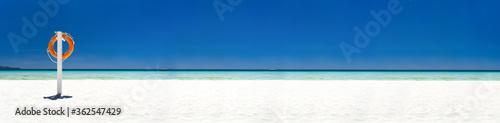 Fototapeta Lifebuoy ring on tropical beach obraz