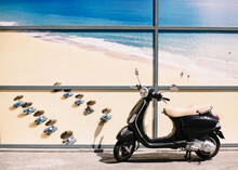 Funchal, Madeira- 20,09.2019. Scooter On The Background Of Advertising A Huge Beach With The Ocean. Vacation Time And Summer Adventures.