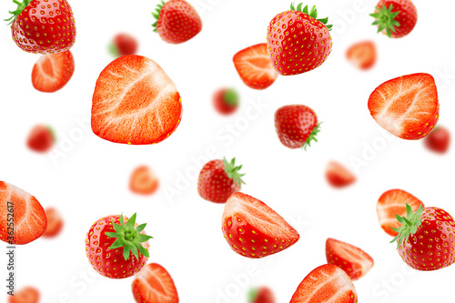 Fotomural Falling strawberry isolated on white background, selective focus