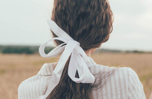 Girl's Hair Braided In A Ribbon