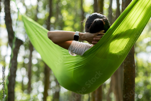 Obraz na plátně Woman relaxing in hammock in tropical  forest