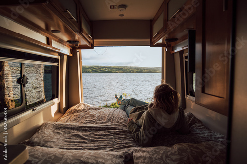 The girls is enjoying a view from the campervan bed on Cape Breton Island Fototapete