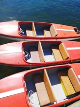 Close-up Of Red Boats Moored In Water
