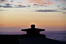 Silhouette Mooring Bite At Beach During Sunset