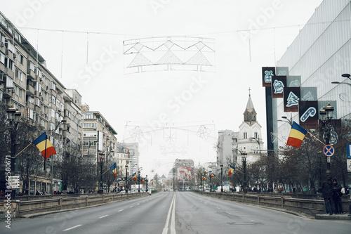 Road By Buildings Against Clear Sky Fotobehang