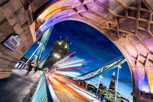 Long Exposure Of Vehicles And People On Tower Bridge