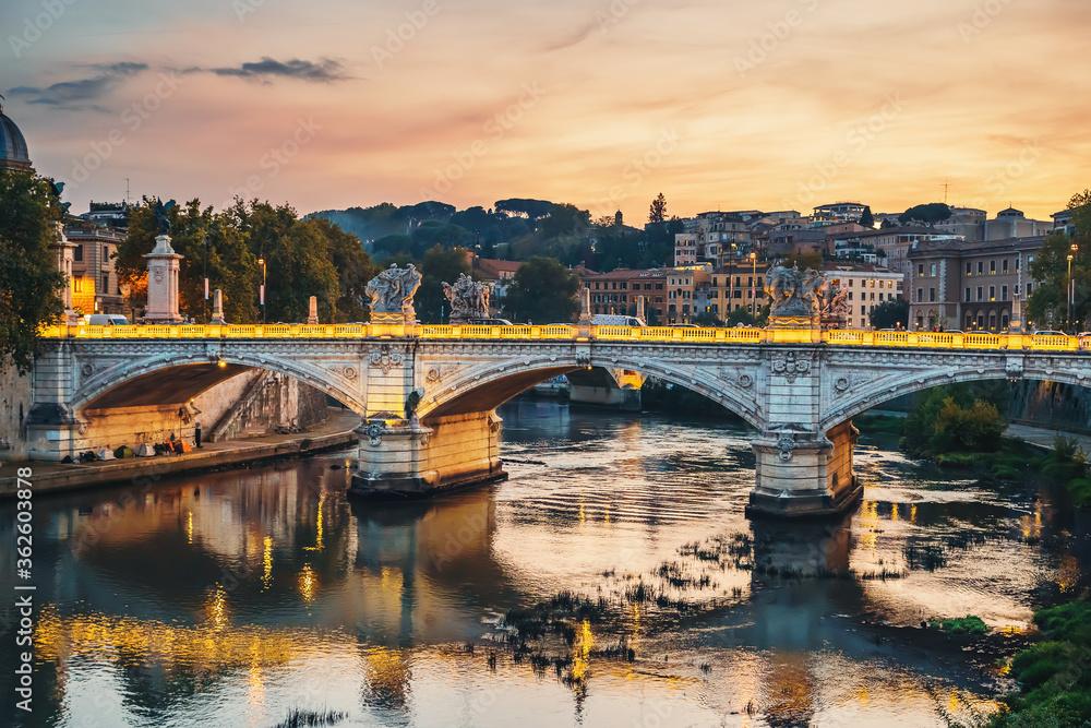 Fototapeta Tiber river with illuminated bridge in Rome evening at sunset, Italy.