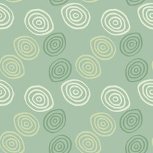 Geometric Pattern In Pastel Colors. Yellow, White And Green Spirals On Light Green Background.