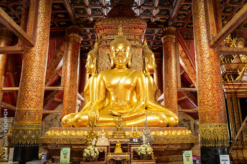 Obraz na plátne Buddha statues in Thai Lue art and Sukhothai style facing the four directions, situated in ordinance chapel at Wat Phumin Temple