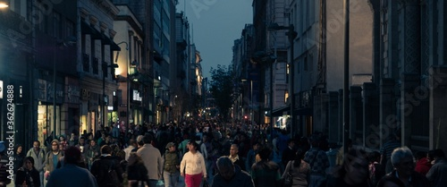 Fotografija Panoramic View Of People In City At Night