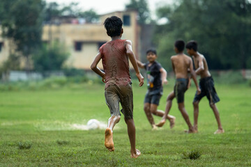 Friends Playing Soccer On Field