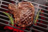 Fototapeta Tulipany - T-bone beef steak cooking on grill