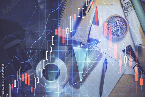Vászonkép Double exposure of forex graph drawing and work table top veiw