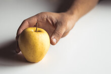 Hand With An Apple On A White ...