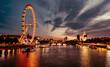 Ferris Wheel In City At Sunset