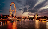 Fototapeta Londyn - Ferris Wheel In City At Sunset