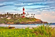 Lighthouse On Beach By Sea Aga...